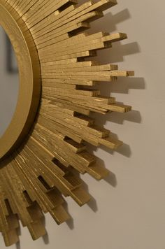 Sunburst mirror made out of paint sticks!