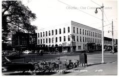 ID#0124 Date: 1950s. This photo shows the original Oberlin Inn building at the corner of North Main and East College street. Its first floor housed a number of businesses: Hanson's Pastries and Candies can be seen on the corner of North Main. The entrance to the inn was at the first awning on East College. A Western Union Telegraph office can be identified just beyond it. Participant: John P. Gorske. Additional Sources: Oberlin Heritage Center: Fred Maddock files.