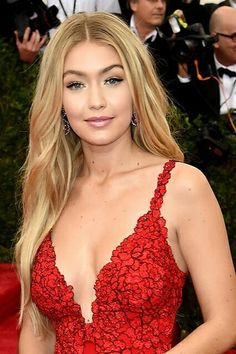 """Gigi Hadid's look could be summed up in two words: simple and elegant. """"Since her dress was red, we wanted to play off the color and give her a pop on her cheeks,"""" makeup artist Patrick Ta says. To get it, he mixed two shades of Maybelline Fit Me Blush in Medium Pink and Coral. He paired that with a nude lip and loads of black liner."""