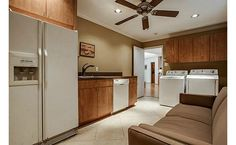 Huge laundry room with second refrigerator- great for a big family!