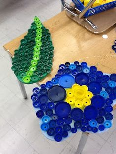 Flowers made from Repurposed .. Recycled Plastic Lids... 2 Liter Drink Pop Caps..  I'm going to make some for the yard.. Or as a mosaic  for on top of my metal table that is missing the top!!
