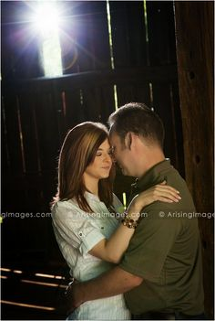 Beautiful engagement photo inside a barn. Love their sweet pose. #engagement #love #couple #barn