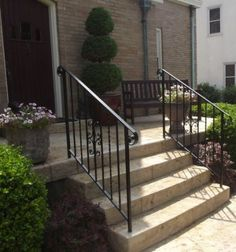These iron stair railings look great with the rest of the house! I really like the black color and the subtle design. Something like this could be a good addition to my front stairs. Porch Step Railing, Wrought Iron Porch Railings, Porch Handrails, Exterior Stair Railing, Outdoor Stair Railing, Front Porch Railings, Iron Handrails, Wrought Iron Stair Railing, Front Stairs