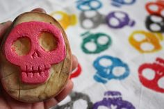 Stamp a fun sugar skull design on an inexpensive kitchen towel for Day of the Dead using a potato.