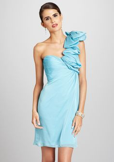 Not a fan of the hugeness of the ruffle shoulder....LOVE the color though.