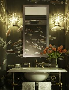 dark flowing fish wallpaper + sconces + white vanity with exposed fittings | via Small & Fabulous ~ Cityhaüs Design