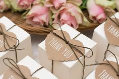 white favor box with a kraft heart tag