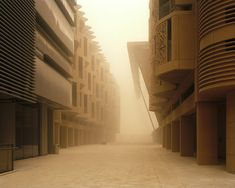 Inside Masdar, the UAE's Zero-Carbon City That Will Never Be | A sandstorm blows through Masdar City.  | Credit: Etienne Malapert | From Wired.com