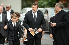 Actor and Martin Crowe's cousin, Russell Crowe (centre) and his sons arriving at the funeral service in Auckland