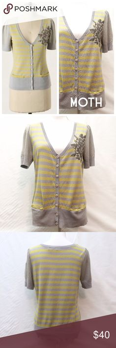Anthropologie Moth Striped Cattleya Cardigan Adorable Anthropologie Moth Striped Cattleya Cardigan. Yellow and gray striped cardigan; short sleeved; front pockets. 60% cotton 40% rayon. hand wash cold. lay flat to dry. Anthropologie Sweaters Cardigans