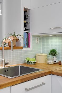 Love the mint colored tiles, wooden built in shelf above sink that matches the countertop and the well styled kitchen corner White Kitchen Cabinets, Wooden Kitchen, Kitchen Tiles, Kitchen Countertops, White Cabinet, Cabinet Doors, Kitchen Corner, New Kitchen, Kitchen Dining