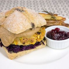 Hazelnut veggie burger with red cabbage, chestnut cream, cranberry jam and rosemary chips