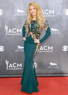 Her hips don't hide! Shakira wears a teal Zuhair Murad gown with an embroidered bodice and nude silk details to the 2014 ACM Awards