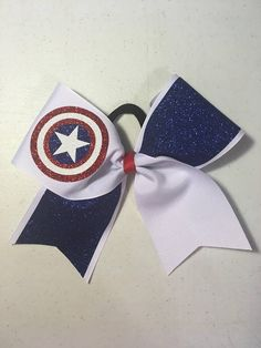 Captain American cheer bow with non breakable elastic hair tie. Cheerleading Bows, Cheer Bows, Captain American, Gift Bows, Elastic Hair Ties, Drink Sleeves, Cheer Stuff, Superhero, Usa