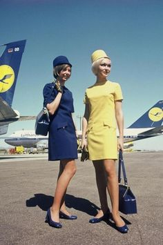 Stewardesses of Lufthansa, German Airlines - note how their uniforms match the paint job on the tails of the planes