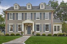 """scale of windows to house...dental molding above 2nd floor windows... copper gutters. .dormers portico"""" """"portico dormers...Portico design"""""""