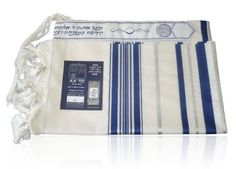 Prima AA Wool Tallit with Blue and Silver Stripes by World of Judaica. $84.00. This PrimaAA wool Tallit features blue and silver stripes on the sides, Atara on the top edge decorated with blue and silver decorations and Tzitzit on its corners. This Prima AA wool Tallit is made from 100% sheep wool and is decorated with silver and blue stripes of different widths on the sides and has knotted fringes on the left and right sides. The Tallit has an Atara mounted at the top t...