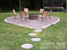 Fire pit area, complete with paver stones leading the way to a graveled spot.  Patio chairs around the fire pit.  Add bushes around the fire pit area and make it more enclosed.  What a great idea!