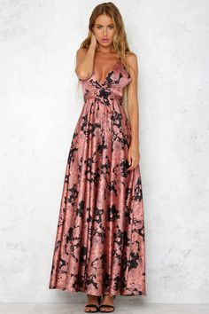 The Starlight Dance Maxi Dress has a overlay front V neckline, a crossover back and rust floral print. The tie around the waist can be worn as a back or front bow. Style with black heels and diamante earrings!   Maxi dress. Not lined. Cold hand wash only. Model is standard XS and is wearing XS. True to size. Print may vary in placement.  Non-stretchy fabric. Polyester.