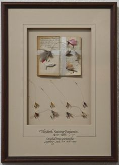 """Elizabeth Staring Benjamin Fly Plate, flies tied between 1858 – 1860.  Handwritten notebook caption: """"My mother Elizabeth Benjamin made these flys by hand in Ralston, Pennsylvania, in the year of 1860."""" — J Benjamin – 1919   """"""""In 1858, just prior to the Civil War, Elizabeth Benjamin, of Ralston, Pennsylvania, became a legend in the area by ingeniously creating a series of wildly successful fly patterns that caught the fancy of wealthy city anglers…"""""""
