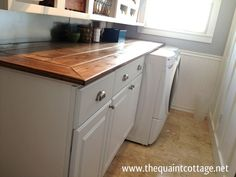 This Awesome Laundry Room Countertop Cost Under $40 To Make!  #thequaintcottage #laundryroom #