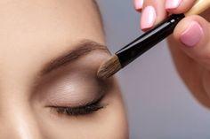 makeup artist apply makeup brush for eyes makeup for young girl brown