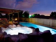 pool with a hot tub