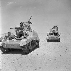 BRITISH ARMY NORTH AFRICA 1942 (E 14119) A Stuart tank towing another away from the forward areas to be repaired, Egypt, July 1942.