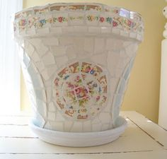 mosaics... pretty way to use broken dishes and thrifty finds