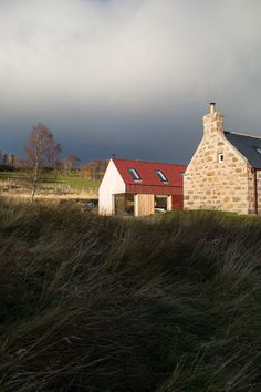 London studio Moxon has restored an old granite farmhouse in the Scottish Highlands, and added a larch and metal extension with a matching gabled profile.