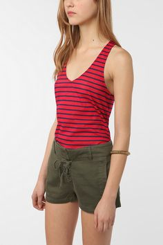 I love this outfit because it's fun but still totally functional. More red! I'm usually not an advocate of stripes but come on, these are adorable. Racy.  I love the military green high-waisted shorts too! You can wear any shoes with this to dress it up or down. Urban Outfitters.