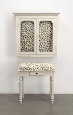 Marcel Broodthaers. Armoire blanche et table blanche (White cabinet and white table). 1965. Painted furniture with eggshells, cabinet: 33 7/8 × 32 1/4 × 24 1/2 in. ; table: 41 × 39 3/8 × 15 3/4 in. The Museum of Modern Art, New York. Fractional and promised gift of Jo Carole and Ronald S. Lauder, 1992. © 2016 Estate of Marcel Broodthaers / Artists Rights Society (ARS), New York / SABAM, Brussels