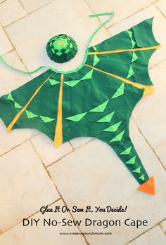 """When I was requested to make a dragon costume for Purim, I knew it would be very loosely a """"dragon costume"""" and in the end, on account of the king masquerade mask, the recipient deemed it """"king of the dragons"""". DIY No-Sew Dragon Cape Jaya claudia Easy Halloween Costumes Kids, Holidays Halloween, Halloween Crafts, Sewing For Kids, Diy For Kids, Capes For Kids, Sewing Diy, Diy Dragon Costume, Make A Dragon"""