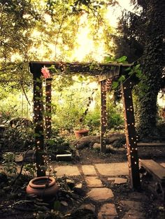 enchanted garden + arbor + fairy lights + cobble stone path