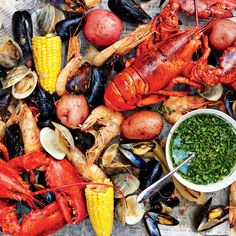 Shellfish Boil with Spicy Green Dipping Sauce Recipe This shellfish boil is a one-pot seafood feast that would take hours on a regular stovetop burner. Lobster Recipes, Shrimp Recipes, Sauce Recipes, Cooking Recipes, Shellfish Recipes, Crawfish Recipes, Yummy Recipes, Dinner Recipes, Healthy Recipes