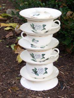 Cute! Tea cup yard art