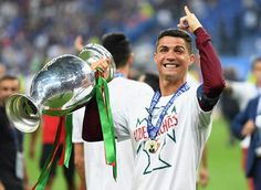 Cristiano Ronaldo of Portugal holds the trophy