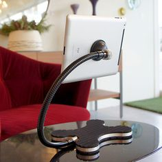 The XFLEX Stand elevates tablet computing to the next level. Portable, stable and simple to use, this hands-free holder is perfect for car trips, presentations or lounging at home. A patented suction cup securely attaches to your iPad, tablet or e-reader, while a flexible gooseneck arm suspends your device in midair. Multiple viewing angles allow you to position the stand for easy reading, helping you get the most out of your tablet wherever you go. $69.95