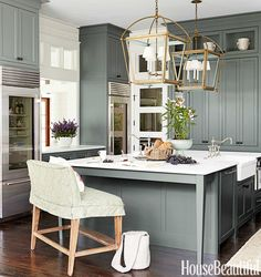 SW retreat -Urban Grace Interiors - Fabulous kitchen features green cabinets painted Sherwin Williams Retreat paired with white marble countertops under kitchen pass through flanked by twin glass-door Sub Zero Refrigerators. Green Kitchen Cabinets, New Kitchen, Kitchen Dining, Kitchen Pass, Green Kitchen Island, Tall Cabinets, Colored Cabinets, Brass Kitchen, Kitchen Sinks