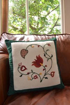 A beautiful hand embroidered crewelwork cushion in Autumnal / Fall colours of…