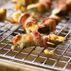 one of my favorite recipes, i take this dish everywhere and its always a hit! simple and quick; jalapenos halved and filled with cream cheese and shredded cheddar, wrap in bacon and secure with toothpicks, i like to top mine with honey bbq sauce. bake at 425 for 25 mins or until bacon is slightly crispy. sooo delicious!