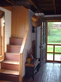 Primitive Entry...old wood floor & stairs.