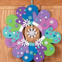Winter Wreath: cute project for kids. Trace hand as mitten and have child decorate! Would be so cute for first or weather day and hang in the classroom... @Lydia Squire Squire Maxson @Megan Ward Ward Smith