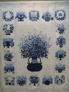 Floral applique quilt spotted at the Tokyo International Great Quilt Festival 2010.  Posted by British Patchwork and Quilting (P and Q magazine).  Eighteen different Baltimore album-style blocks surround a huge urn of flowers.