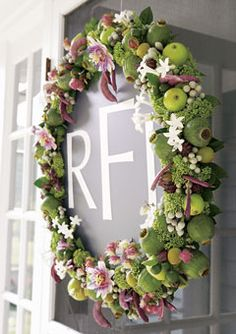 I wouldn't necessarily use a fruit wreath but I like the monogram in the middle.