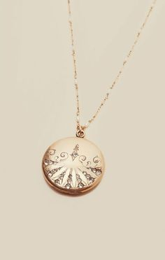 Own a piece of history with this timeless Victorian Locket Necklace by Natalie B. The Natalie B Sweetheart Collection features vintage lockets circa the 1800's traditionally used for women to carry keepsakes, pictures and other sentimental mementos.Made in USAVictorian Locket Circa 1800's14k Gold Filled Chain with Fresh Water Pearl AccentsOne of a Kind Gold Filled Double Photo Locket Pendant with Paste Stones30