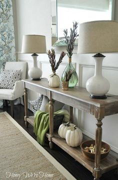 Fall Decor // Console Styling FROM BLOG-SOURCE LIST: CONSOLE TABLE // World Market GOLD VASE, GREEN VASE, WOVEN BASKET // HomeGoods LAMPS, WHITE PUMPKINS // Hobby Lobby GOLD PILLOW, GOLD VOTIVE HOLDER // Target GREEN THROW // West Elm RUG // Pottery Barn (similar) CHAIRS // Restoration Hardware GEOMETRIC PILLOWS IN CHAIR // Etsy Festive Home Decor GEOMETRIC FABRIC FOR PILLOW IN BASKET // High Fashion Home, Dwell Studio Fabric WOODEN BOWL // HomeGoods???