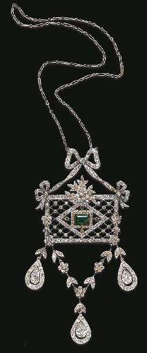 A BELLE EPOQUE DIAMOND AND EMERALD PENDANT  The single, old mine and old European-cut diamond ribbon, suspending a detachable similarly-set rectangular-shaped plaque of lattice motif, enhanced by old European-cut diamond foliate detail, to the central rectangular-cut emerald, and three circular-cut emerald accents, joined to an articulated similarly-set garland motif, with knife-edged spacers, and three pear-shaped diamond terminals, each within old European-cut diamond independent frames,