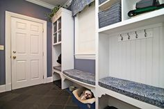 Traditional Mud Room with Crown molding, Built-in bookshelf, soapstone tile floors, Daltile slate in brazil grey