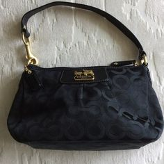 Coach small shoulder bag or wristlet Cute light weight purse with pretty purple lining. In like new condition ready for a night in the town! Coach Bags Shoulder Bags